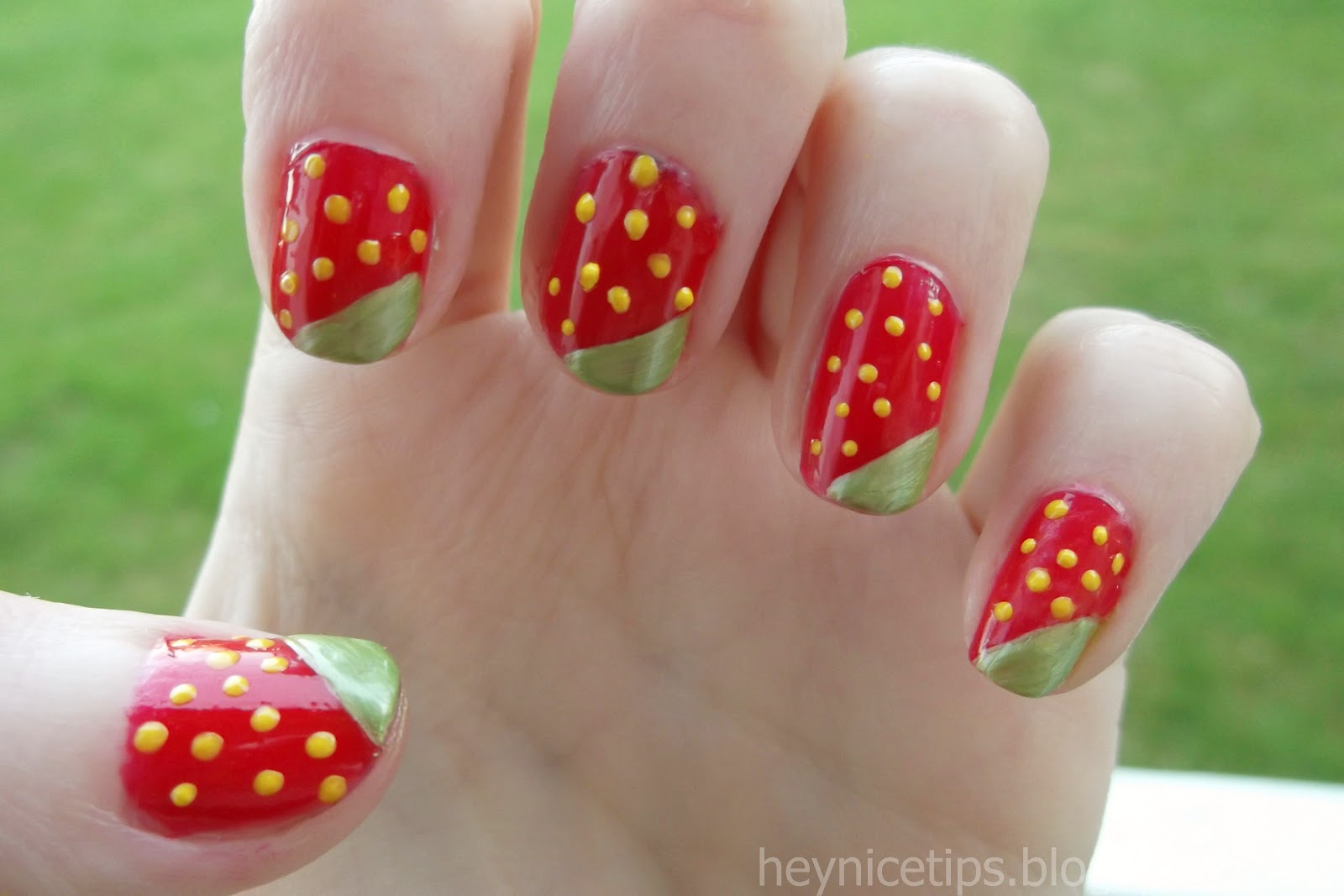 few as you want and this is the finished strawberry nail art design