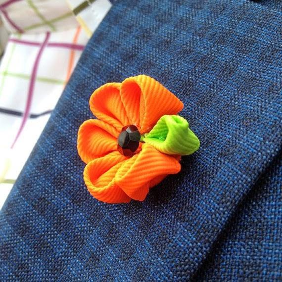 https://www.etsy.com/listing/152940656/mens-lapel-flower-in-neon-orange-mens?ref=favs_view_6