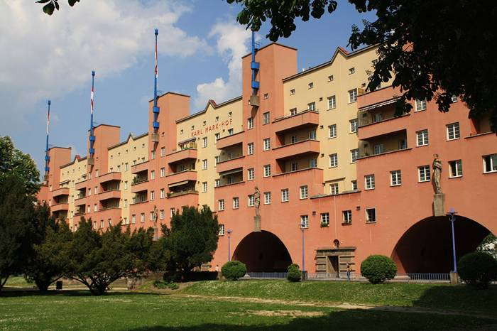 Karl-Marx-Hof in Vienna is the world's longest residential building, stretching more than a kilometre through the 19th district better known for large houses and diplomatic residences. The building consists of almost 1,400 apartments, meant to house up to 5,000 people. The design included amenities such as a swimming pool, library, laundries, shops, a school and medical facilities. Only the eastern side of the building stretches the full 1,100 metres, but in many sections there are blocks on the western side of the development which create internal courtyards and parks for the residents. The building consists of almost 1,400 apartments, meant to house up to 5,000 people. The design included amenities such as a swimming pool, library, laundries, shops, a school and medical facilities. Only the eastern side of the building stretches the full 1,100 metres, but in many sections there are blocks on the western side of the development which create internal courtyards and parks for the residents.