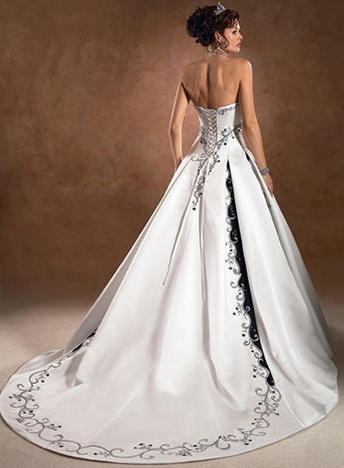 sleek white wedding dress with corset back behind wedding dress