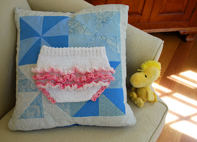 knitted diaper cover with pink ruffles