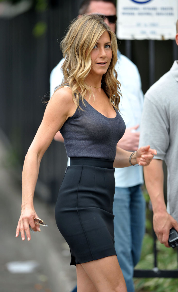 Jennifer Aniston In A Simple Blue Vest And Tight Black Skirt