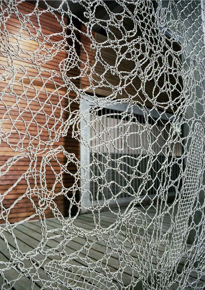 Turning chain link fencing into art lace fences by