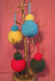 http://www.ravelry.com/patterns/library/crocheted-holiday-ornaments