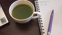 Green matcha tea in cup