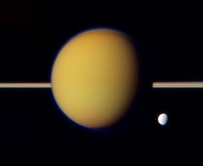 Titan with little moon Dione