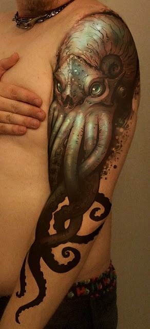 Super realistic octopus tattoo on full arm