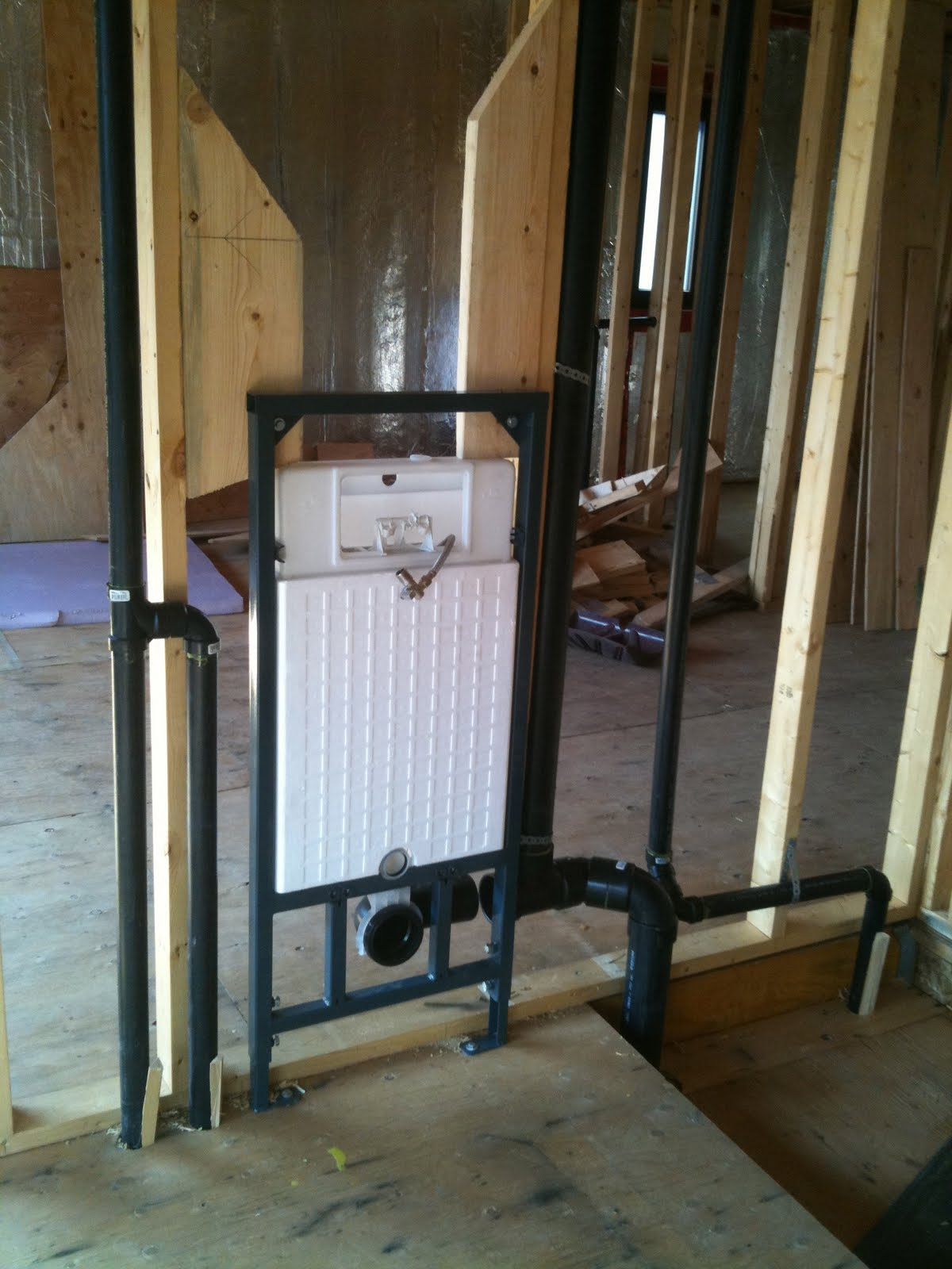 The reno coach passive house project in toronto we got for Rough plumbing toilet