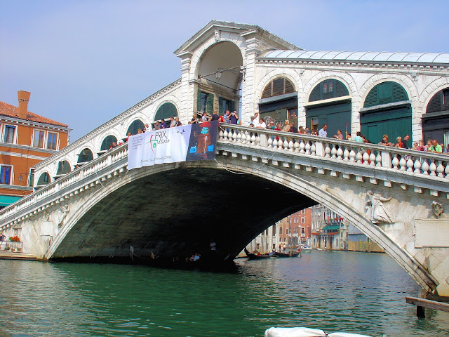 The most ornate and oldest of the four bridges that span the Grand Canal, the Rialto Bridge is named after the centuries-old commercial center of Venice.