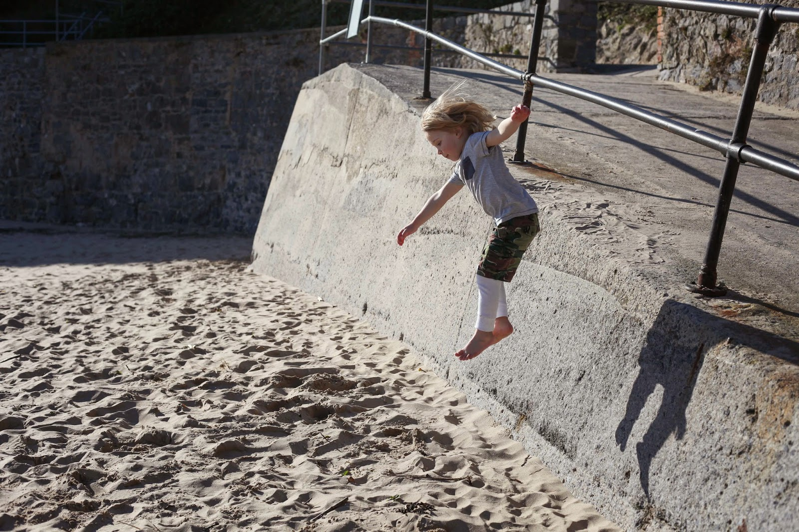 jumping into the sand