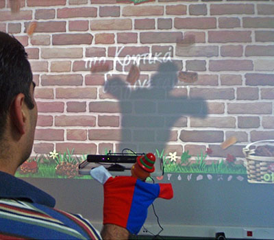 A Kinect game being played with a glove puppet as an alternative access method.