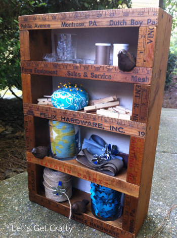 Vintage yardstick enhanced shelf by Let's Get Crafty, via I Love That Junk