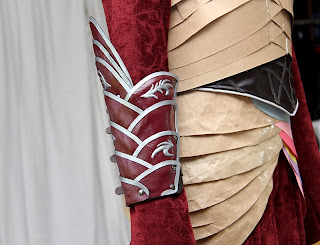 Lord Elrond arm bracers on the dress form.