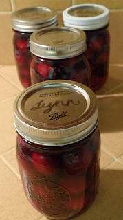 Four Jars Cherries Labeled with Names