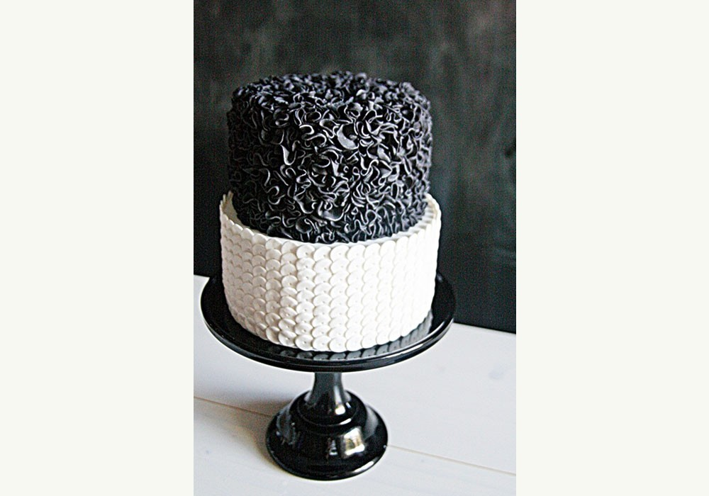very chic two tier black and white wedding cake from sweet bloom cakes