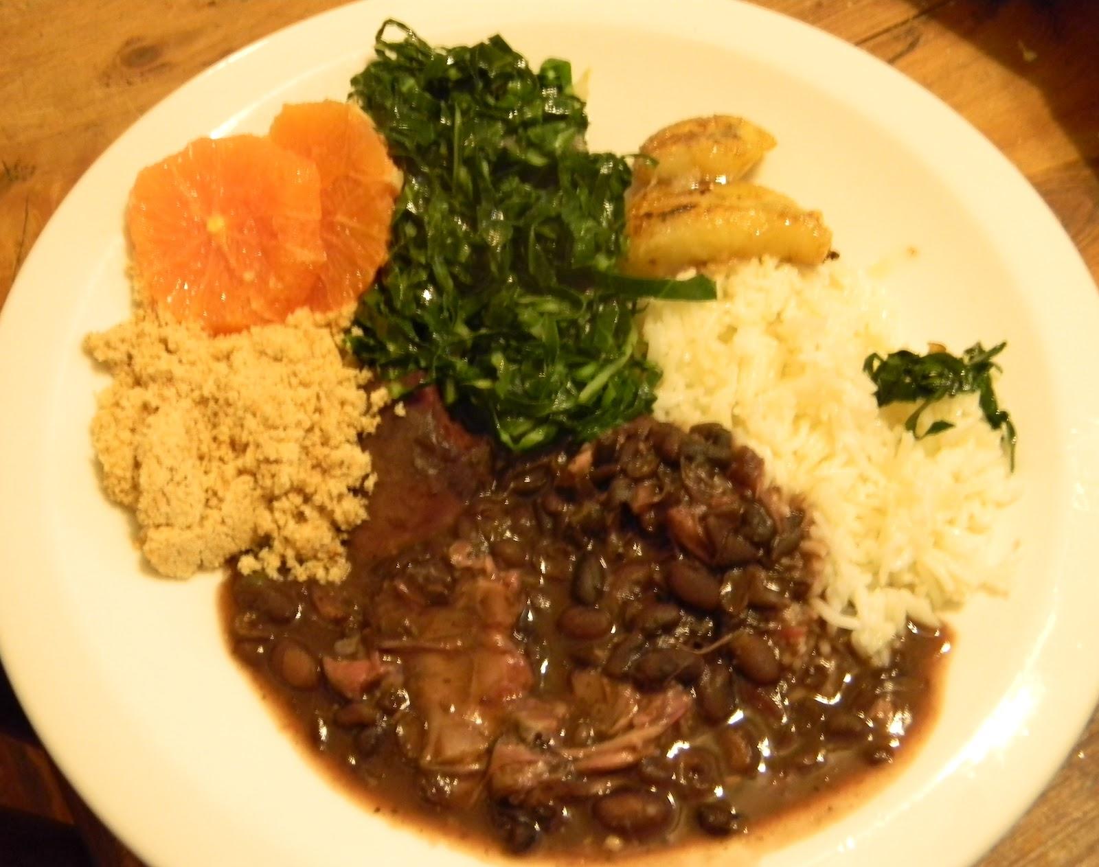 Black beans, rice, collard greens, sauteed bananas, orange slices, and ...