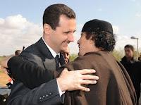 Syrian President al-Assad and former Libyan leader Col. Gaddafi