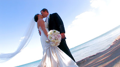 Romantic Couple Wedding on beach with blue sky