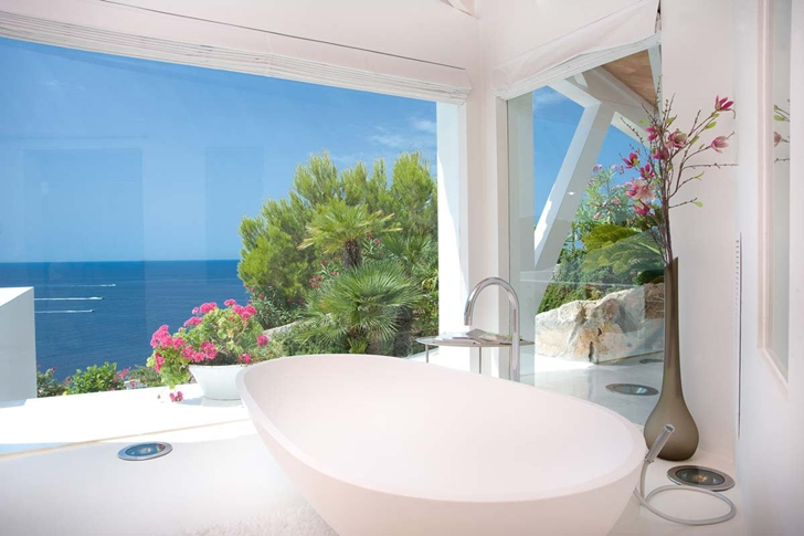 Bathtub by the window in Mediterranean villa in Mallorca by Alberto Rubio