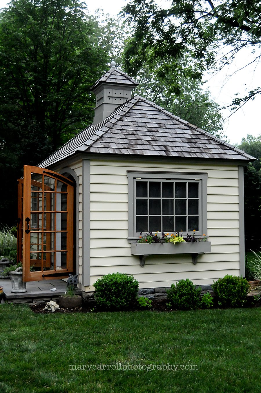 Little red house garden shed for Small backyard cabin