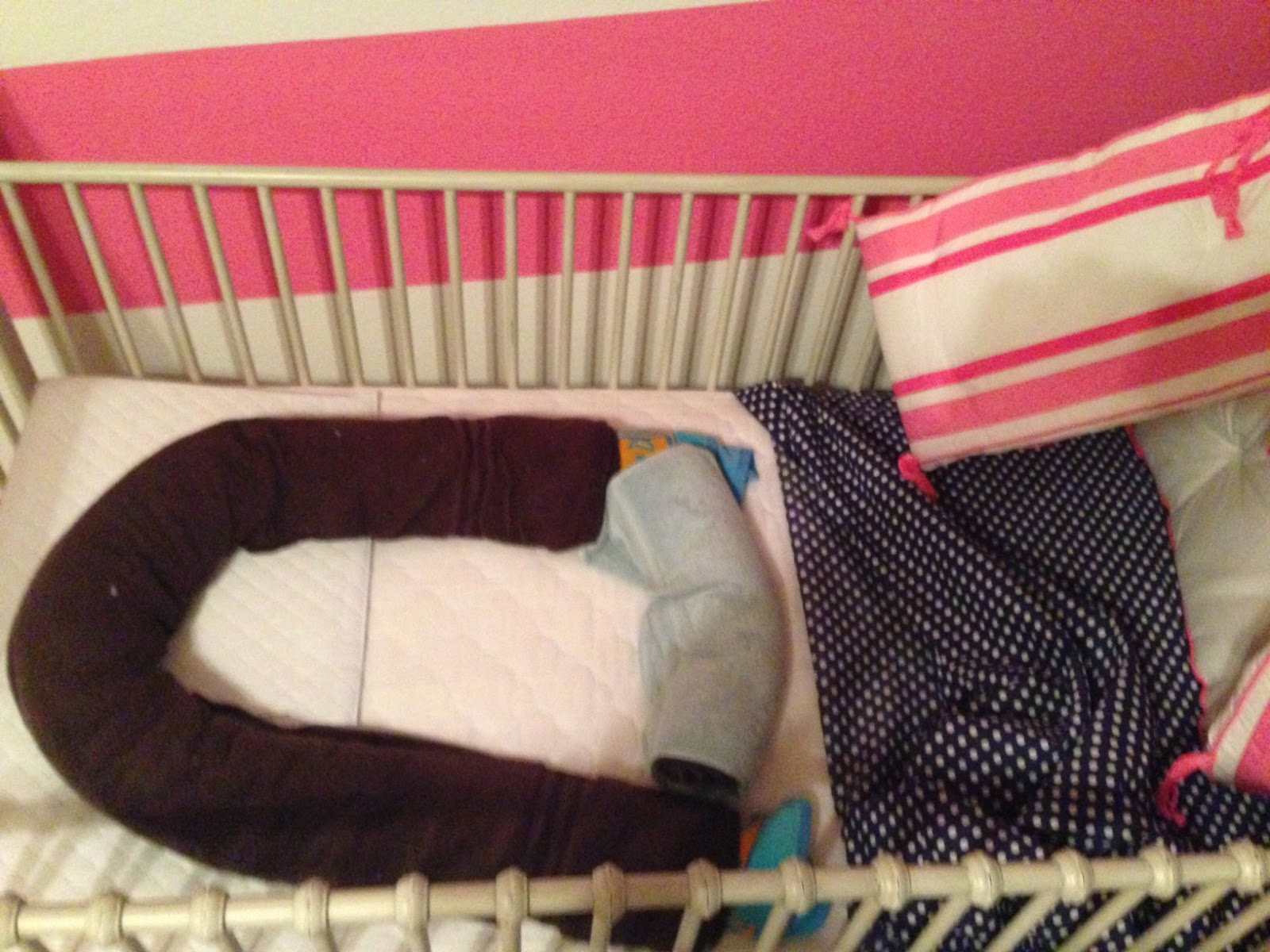Crib wedges for babies - After Putting The Sheet Back On We Took A Couch Pillow And Stuffed It At The Bottom Of The Crib So That If She Scooted Down At All Through The Night