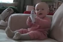 laughing baby tearing paper This is the funniest thing ever the baby keeps laughing every time he wripes the paper.