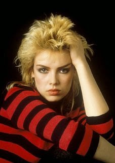 Kim Wilde wearing a black and red striped top