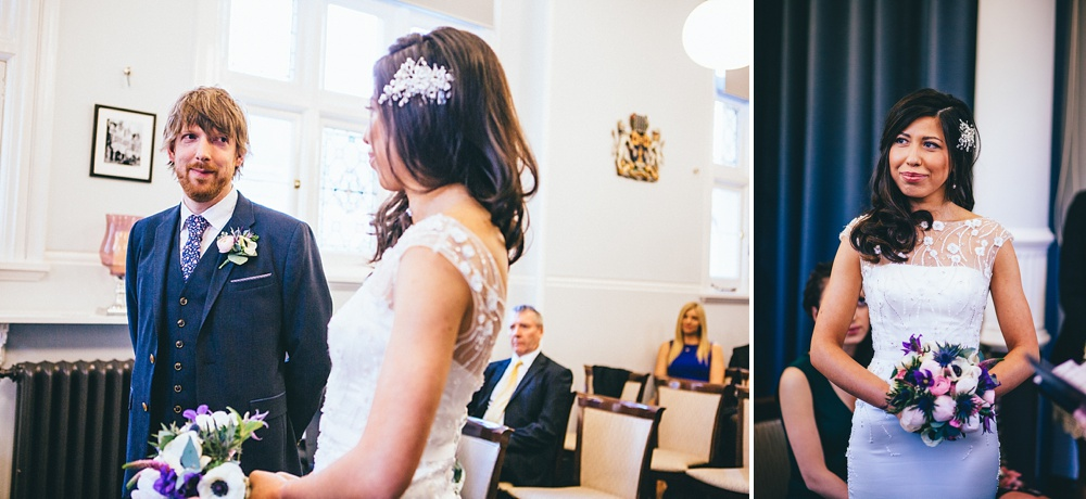 groom and bride look at each other during wedding ceremony photograph