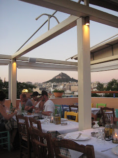 The view of Lycabettus Hill from a restaurant in the historical Plaka district.
