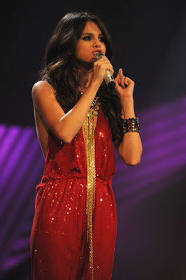 Fashionista and singer Selena Gomez style outfits red sequin jumpsuit.