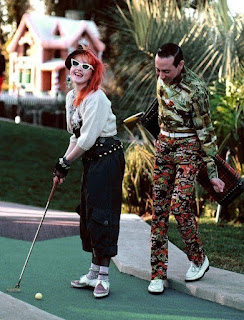 Cyndi Lauper playing mini golf with Pee Wee Herman.