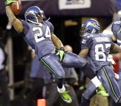 Marshawn Lynch, grasping balls. - #seahawks #MarshawnLynch