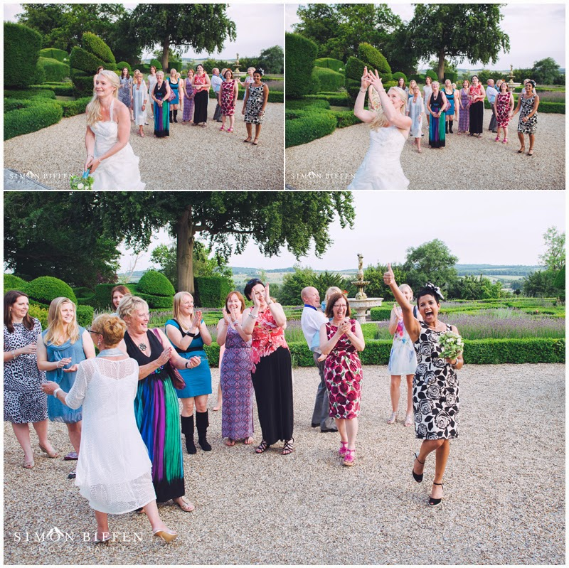 Throwing the bouquet at Danesfield House wedding