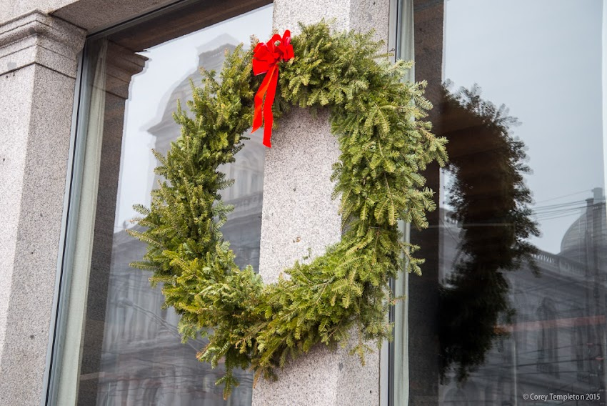 Portland, Maine USA December 2015 photo by Corey Templeton. A festive wreath on the side of the Thomas Block building at 100 Commercial Street.