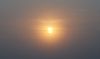 The sun starting to burn through the mist