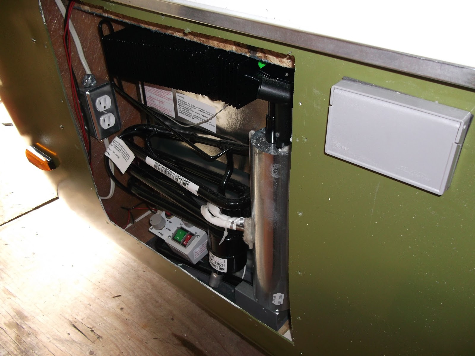 Here is the back of the fridge with its 120 volt and 12 volt supplies.
