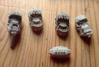 Blood Bowl orc heads by Puppets War