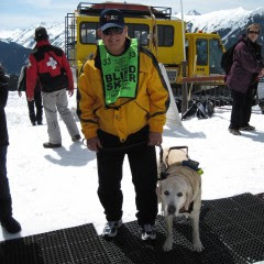 Jim and yellow Lab Atticus at ski resort