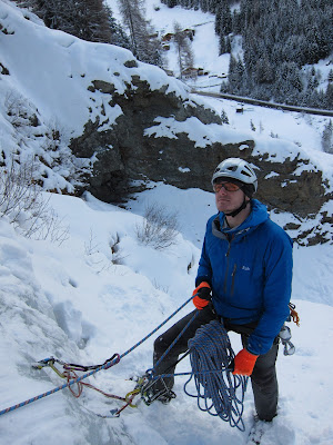 At the belay while ice climbing in Autria
