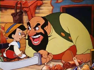 Stromboli with a sword and the boy in Pinocchio 1940 disneyjuniorblog.blogspot.com