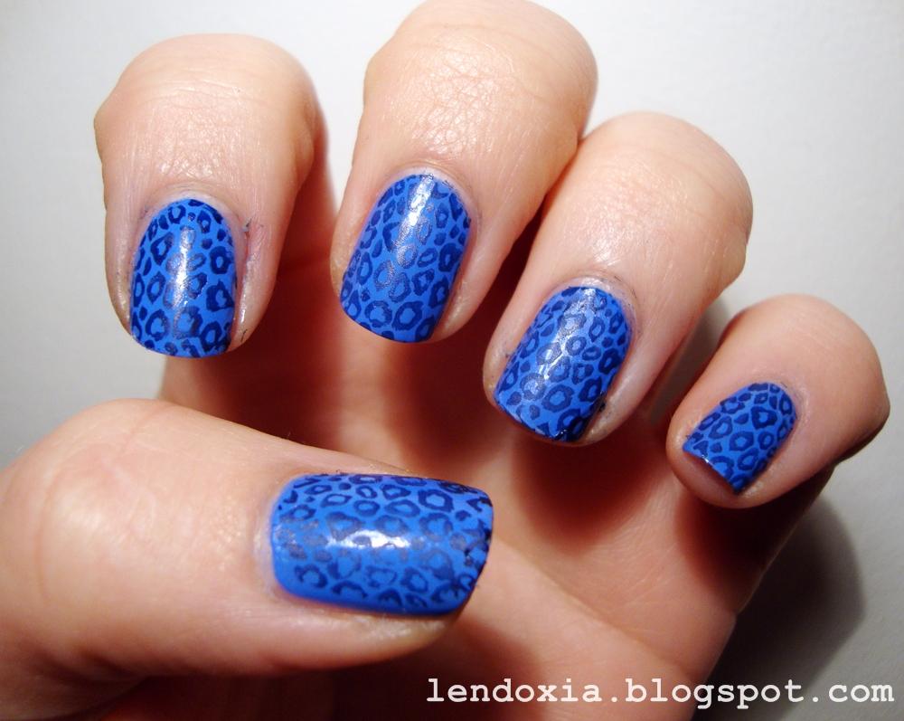 blue leopard print manicure