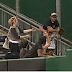 Pirates fan barrels over kid chasing ground rule double (Video)