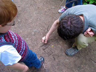 Hubby writing Mister's name in the dirt with a stick