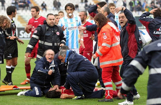 Medics treat Livorno player Piermario Morosini after he suffered a cardiac arrest on the pitch