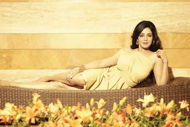 Sridevi lying down in a yellow gown  - (2) - Sridevi PHOTOSHOOT HOT PICS
