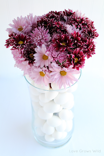 Stacked Egg Floral Arrangement by Love Grows Wild www.lovegrowswild.com #flowers #decor #spring