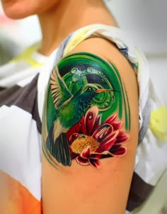 Birds tattoos:Colorful Humming bird tattoo on shoulder
