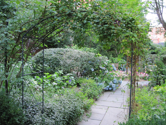 Stroll down the path through the Gardens of Saint Luke at the Fields in this quaint Old New York spot