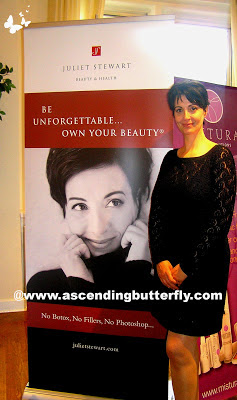 Juliet Stewart stands by her display at The Beauty Press Spotlight Day at Midtown Loft in New York City
