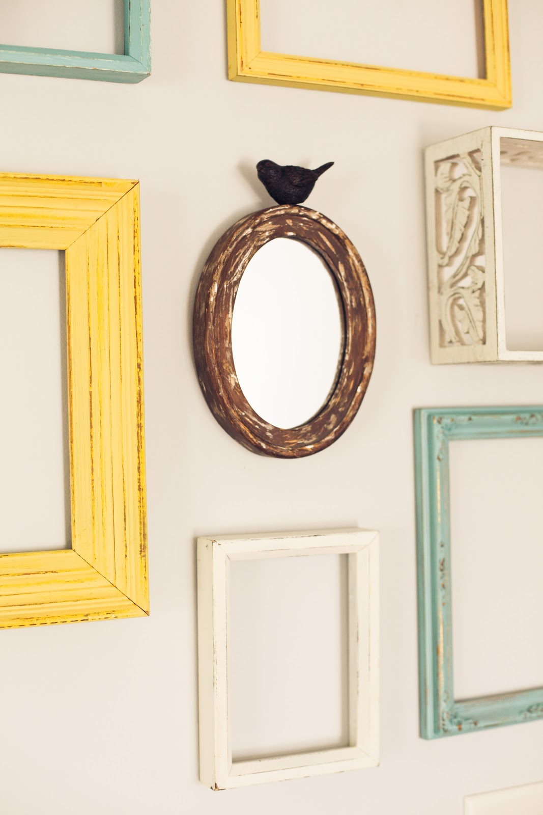 The green dresser reusing empty frames for wall art for What to do with empty picture frames